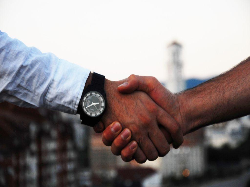 Two men shaking hands.
