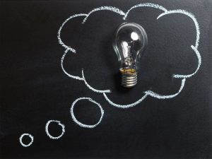 A light-bulb placed inside a chalk thought bubble on a blackboard. We've put a lot of thought into our relocation methods!