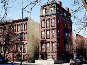 A street corner in Brooklyn during the day. Hiring movers Sunset Park means moving to one of the best historic neighborhoods in Brooklyn!