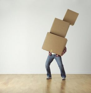 Man carrying some boxes.