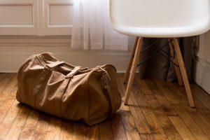 A brown bag next to a chair