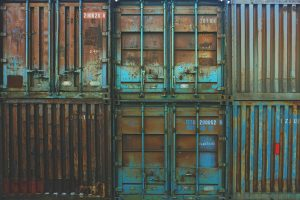 A stack of dirty and rusty storage units.