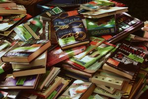 A pile of books haphazardly thrown about.