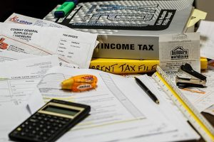 Messy table, with tax documentation.