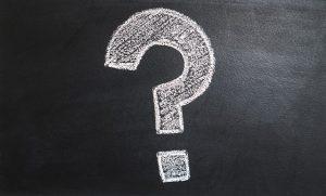 Question mark written on a black board.