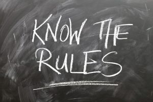"a blacboard with written ""know the rules"""