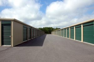 Storage units with green doors.
