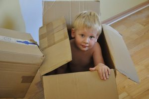 toddler in a moving box