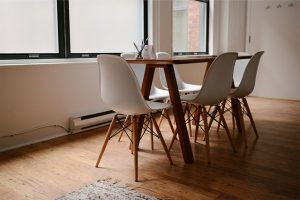 A dining room with chairs and a table