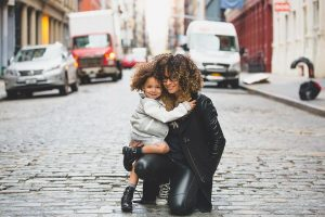 Mom with her daughter on the street
