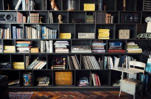 Black floor-to-ceiling shelves.