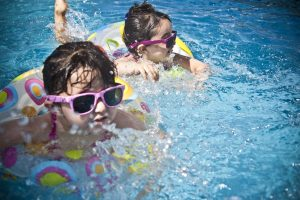 Two little girls swimming in a pool