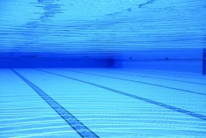 Underwater photo of a swimming pool. Public pools are the perfect places to swim in Brooklyn.
