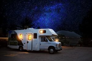 RV under a beautiful nightsky filled with stars