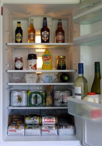 The fridge with food and drinks inside