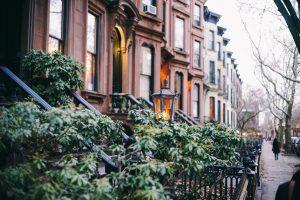 NYC neighborhoods for raising kids - a row of houses