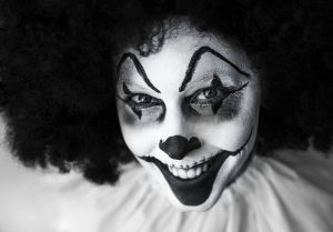 A black and white creppy clown